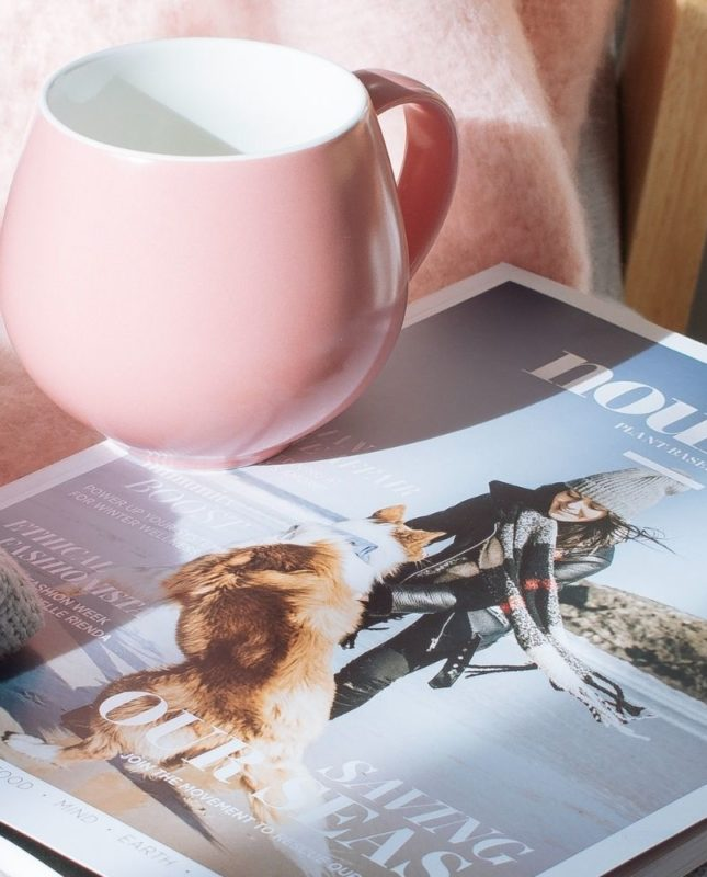 small business media coverage magazine and cup and blanket